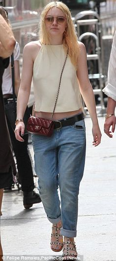 Dakota Fanning paired a feminine tank top with laid-back boyfriend jeans, a covetable red quilted Chanel bag hung across