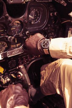 leather gloves and a timeless watch in the cockpit
