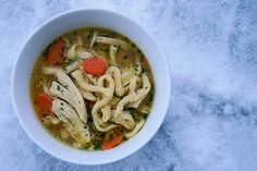 Homemade chicken stock and chicken noodle soup with fresh egg noodles. Recipe from @missangeladavis.