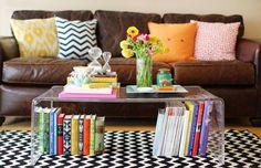 Learn how to style a coffee table in four easy steps! These coffee table decor ideas are fresh and fun, and can be easily recreated in your home! Clear Coffee Table, Coffee Table Styling, Coffee Tables, Home Library Design, House Design, Bright Pillows, Colorful Pillows, Throw Pillows, Scatter Cushions