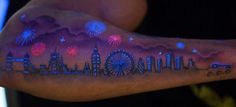 Okay, i'm really not a tattoo fan, but this is cool!  Amazing UV Tattoo