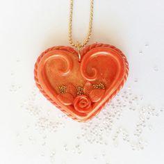 Ciondolo cuore arancione.  Fatto a mano in pasta polimerica. Hand made in polymer clay. Link al mio Etsy Shop nel profilo. ;)