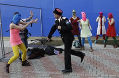 A Cossack in Russia whipping a Pussy Riot member during a protest performance in Sochi