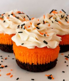 This is one of my favorites a pumpkin cupcake just bake vanilla cupcakes add orange and black food dye and then add frosting and sprinkles