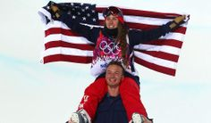 Maddie Bowman of the United States celebrates winning the gold medal with David Wise.
