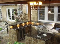 Outdoor kitchens are the perfect way to enhance patios, yards and outdoor spaces. They are responsible for bringing friends and family together in a communal setting while acting as the ideal cooking spot. Most homeowners also consider paradise outdoor. Outdoor Kitchen Countertops, Backyard Kitchen, Outdoor Kitchen Design, Backyard Patio, Outdoor Rooms, Outdoor Living, Outdoor Decor, Outdoor Kitchens, Outdoor Kitchen Bars