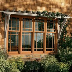 Marvin Ultimate Double Hung Windows, cottage style (smaller top sash) with SDL's. Exteriror cladding is annodized aluminum