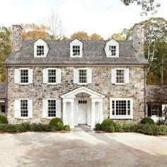 stone house with boxwoods