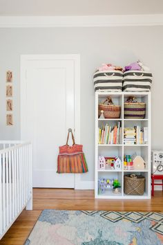 Playful toddler's room with lots of basket storage and colorful rug