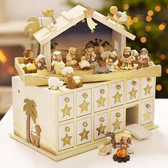 """I really like this idea: the """"surprise"""" in the boxes is different figures to create the nativity scene... a great way to tell stories and make kids entertained during the long wait. You could tell any story this way... one could make hand puppets... hmm... yes"""