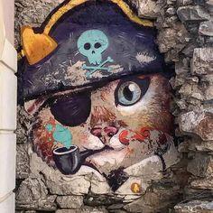 Pirate cat graffiti by Paris Xyntarianos Tsiropinas (Really? Team) at Hermoupolis, Syros island, Greece