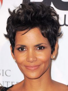 """PIXIE CUT Forget everything you've heard about short curly hairstyles. Halle Berry's tough-but-feminine crop works on nearly any texture, and isn't as high-maintenance as you'd think. Ask your stylist for a graduated pixie style. """"You don't want a precision cut,"""" says Morgan Willhite, creative director at Ouidad. """"It should be longer on top to show off the texture and choppiness."""" Let it dry naturally and use a frizz-control product, like Tigi Bed Head Candy Fixations Totally Baked…"""