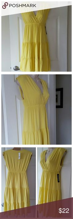 "New Yellow Sun Dress New with tags. New York & Company STRETCH dress. Low, v-neck cut with empire waist. Stretchy and very soft. 95% Rayon, 5% Spandex. Only flaw, initials written on inside tag as shown in 4th pic.   Measurements*:  33"" Relaxed Bust   12"" Empire Flat Waist  35.5"" Length (Shoulder to bottom hem) *Very stretchy material, all measurements taken laying flat. New York & Company Dresses"