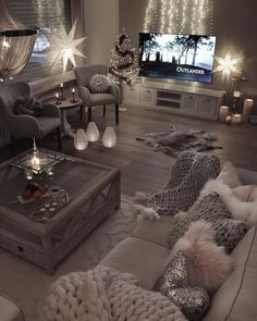 The fur rug would have to go (even if it's fake), but the rest of the room is so gorgeous and cozy!