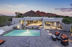 Paradise ValleyParadise Valley Homes For Sale.  $2,575,000, 4 Beds, 6 Baths, 6,121 Sqr Feet  This luxury contemporary was built in 2015 and boasts postcard views of Camelback and Mummy Mountains, N/S exposure, exquisite clean lines, 12' ceilings, masterful interior design by Angelica Henry, two master suites, two full laundry rooms, unique quartzite kitchen counters, and ample natural light  http://mikebruen.sreagent.com/property/22-5482751-4700-E-Sierra-Vista-Drive-Paradise-Valley..