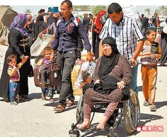 IS前天佔領伊拉克的拉馬迪。圖為逃到巴格達附近、流離失所的民眾。路透
