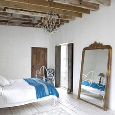 French inspired shabby chic bedroom, bare wooden beams