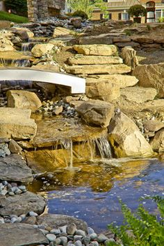Bubbling Stream with Boulder Stairs and Decorative Bridge