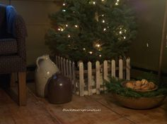 A small decorative picket fence around the Christmas tree helps ...