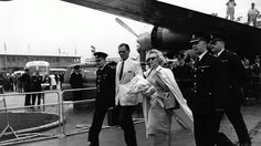Circa 1956: American actress Marilyn Monroe arrives at London airport with her husband, playwright Arthur Miller. (Terry Fincher & Douglas Miller/Keystone/Getty Images)  - Glamour in the Skies: Vintage Air Travel Photos | The Weather Channel