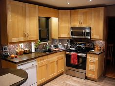 IKEA Adel Birch cabinets - shows what a real, small kitchen actually looks.  They shoulda used crown molding to finish it off though.