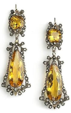 ANTIQUE DIAMOND AND CITRINE DROP EARRINGS. A pair of fine antique diamond and citrine drop earrings, each earring set with a cushion and pear shape citrine within a bow and swag old-cut diamond surround, Mounted in silver on gold. Jewelry Gifts, Jewelry Accessories, Fine Jewelry, Jewelry Design, Gold Jewellery, Jewelry Box, Jewelry Model, Black Jewelry, Designer Jewelry