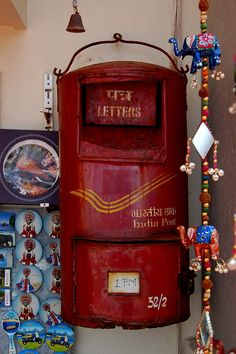 Mail box between the souvenirs of a little store in the Kovalam beach, Kerala, India.