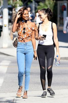 All smiles: Jasmine Tookes (left) will soon be hitting the runway for the annual Victoria's Secret Fashion Show, while Shanina Shaik (right) will not be, but their professional lives didn't seem to put a rift in their friendship as they were spotted together in Los Angeles on Friday