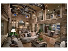 Open concept living room...taken to the extreme! The Overlook at Heritage Hills Mediterranean living room.