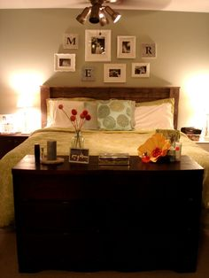 The headboard is made up of pallets...could be really cute painted white.