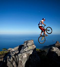 Kenny Belaey performing tricks a staggering 3,558 feet above sea level on Table Mountain, overlooking Cape Town, South Africa.