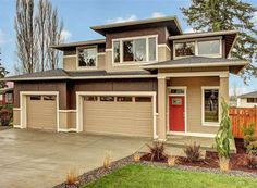 This new contemporary house plan is a big seller in Canada because of its energy efficient design and compact footprint for a narrow lot. View more photographs and the floor plans to this 2,400 square foot two-story home. http://www.thehousedesigners.com/plan/5549/