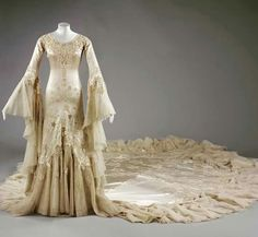 Wedding dress, by Norman Hartnell, ca. 1933. Worn by British socialite Margaret Whigham, later Duchess of Argyll, for her marriage to Charles Sweeny.  The bride created a sensation in this dress and supposedly blocked traffic in Knightsbridge for 3 hours. Victoria and Albert Museum