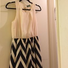 Classy Chevron Dress Cream and black chevron skirt detail. This dress is prefect for date night or for work depending on your office's dress code. Dress is from a local Houston boutique called Langford Market that emphasizes is limited quantity of merchandise (6 of each item). They have their own in house brand called Maude. Never been worn. Langford Market Dresses