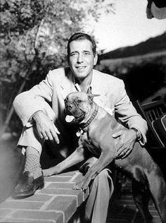 Humphrey Bogart with his pet boxer, circa 1949.