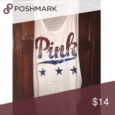 Victoria Secret Pink tank top adorable white tank to keep you cool and cute during summer! sequin lettering in patriotic colors which would be perfect for the upcoming months Victoria's Secret Tops Tank Tops