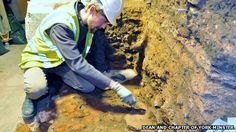 Archaeologists have unearthed a section of Roman road beneath York Minster.    The road was found during construction work for new visitor displays in the medieval minster's undercroft.    The York Archaeological Trust said the road was probably a backstreet that ran behind the Roman basilica, the site the minster sits on.