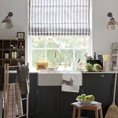 Charcoal grey country-style kitchen Natural materials such as wood and linen combine with a dark grey paint colour for a sophisticated look in this country kitchen. Blind fabric Volga Linen Cupboard Railings paint Farrow & Ball  Read more at http://www.housetohome.co.uk/room-idea/picture/grey-kitchen-colour-scheme-ideas/7#46kBeZR2xmVSf15B.99