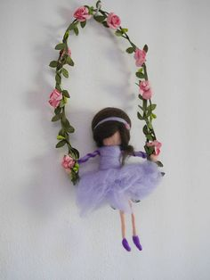 Violet needle felted fairy doll sitting on a swing decorated with pink flowers.  This beautiful mobile with its gentle fairy doll could be a beautiful gift for every occasion on for everyone. The fairy made by the needle-felting technique, made of high quality, gentle very soft Merino wool.  She will fill your life with warmth and charm, you can hang her your living room, bedroom or nursing room.