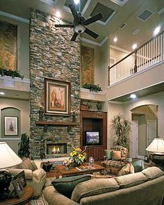 Don't like the fireplace but love the balcony overlooking the living room.