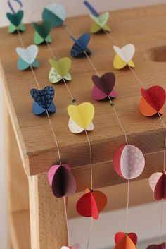 Paper Garland easily made out of 4 circles glued together. Can also make out of paper flowers, whilst watching tv!