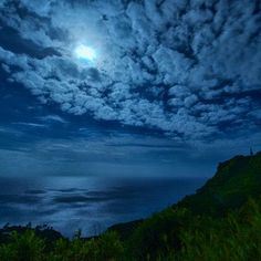 Moonlight streams through the clouds over Bounty Bay on remote Pitcairn Island. Coastalliving.com