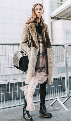 Take your favorite winter coat and wear it on top of a ballerina inspired tulle dress.