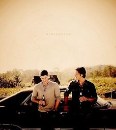Winchester Brothers, having a Beer leaning against the Impala.