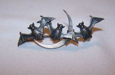 Victorian sterling bat trio and crescent moon brooch
