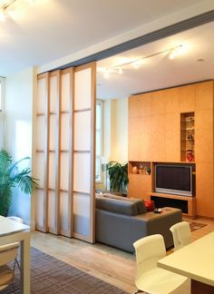 Our sliding walls, also called interior room dividers, have four alternative systems, which means you can find the perfect room dividing solutions for your space. Bedroom Divider, Living Room Divider, Room Divider Walls, Sliding Door Room Dividers, Partition Door, Hanging Room Dividers, Dividers For Rooms, Wall Dividers, Living Room Partition Design