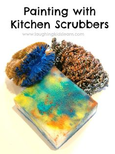 Using kitchen scrubbers as a tool for painting. Great sensory experience and lots of fun.