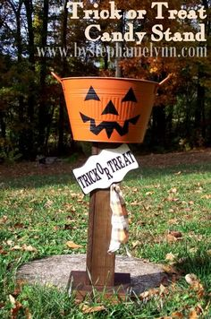 DIY Halloween Pumpkin Trick or Treat Candy Stand {plant holder} ~  a fantastic way to leave treats on your doorstep for the trick-or-treaters when you are out and about with your own little ones... When it's not filled with candy it's a perfect stand to hold a mum or fall flowers.