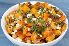 Greek Butternut Squash Salad | Salty feta cheese and olives are the perfect flavor balance to sweet, caramelized butternut squash in this simple, satisfying side dish. Bulk the salad up with rotisserie chicken and serve over bulgur, rice, or couscous for a hearty fall entree.
