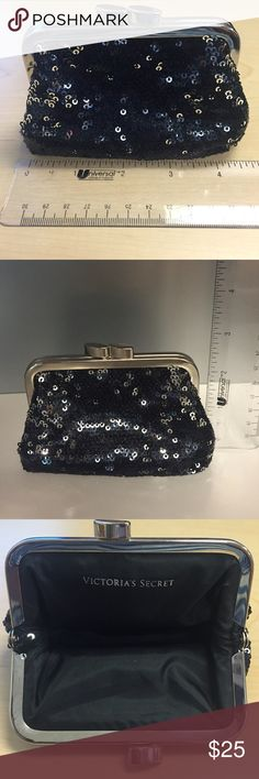 "Change Purse with clasp (never been used) adorable black sequence change purse.  The purse is approx. 4"" in length and just over 2"" in height.  Metal clasp functions and has no visible signs of rusting, large deep scratches or dents.  Inside of purse is perfect and there are no snags in the sequence.  Perfect touch of bling for a night out when you don't want to drag a ""suitcase"" (much like myself).  There is no reason for me to keep it, would love to see it go to someone who would use it…"